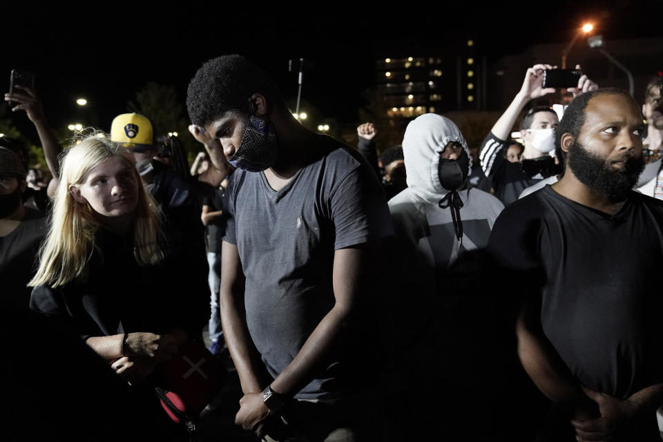 FILE - Protesters gather at the site of a Tuesday night shooting on Wednesday, Aug. 26, 2020 in Kenosha, Wis. A white, 17-year-old was arrested Wednesday after two people were shot to death during a third straight night of protests in Kenosha over the police shooting of a Black man, Jacob Blake. (AP Photo/Morry Gash, File)