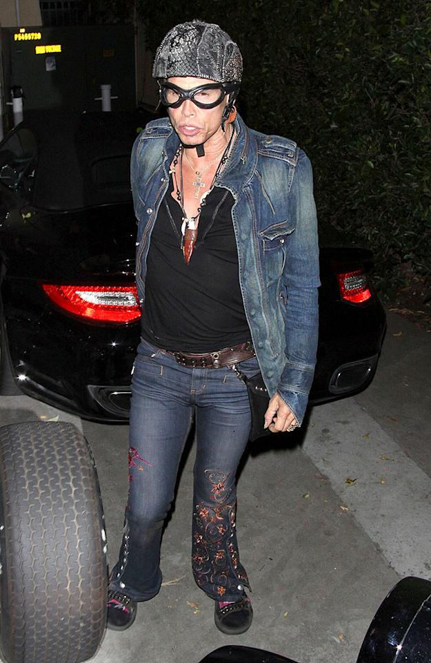 """Who's that under the helmet and goggles? Why it's Steven Tyler, of course. The Aerosmith frontman and former """"American Idol"""" judge was snapped wearing a denim jacket and embroidered bell-bottom jeans as he hopped off his motorcycle in Los Angeles."""