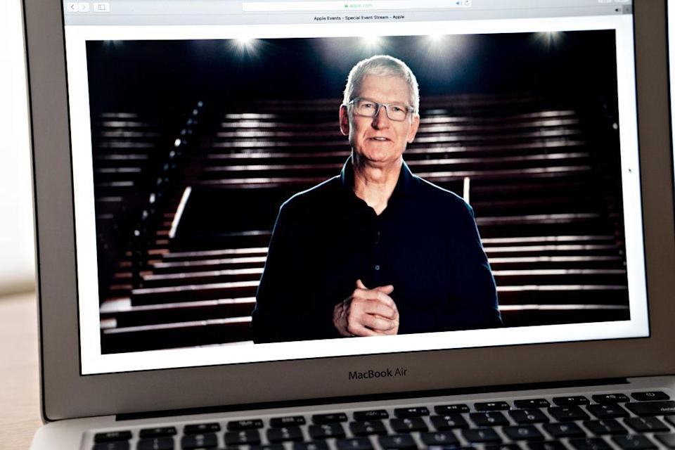 Tim Cook, chief executive officer of Apple Inc., speaks during the Apple Worldwide Developers Conference seen on a laptop computer in Arlington, Virginia, U.S., on Monday, June 22, 2020. Apple will walk into its annual development conference facing one of the biggest backlashes from its giant community of creators since the App Store started almost 12 years ago. Photographer: Andrew Harrer/Bloomberg via Getty Images