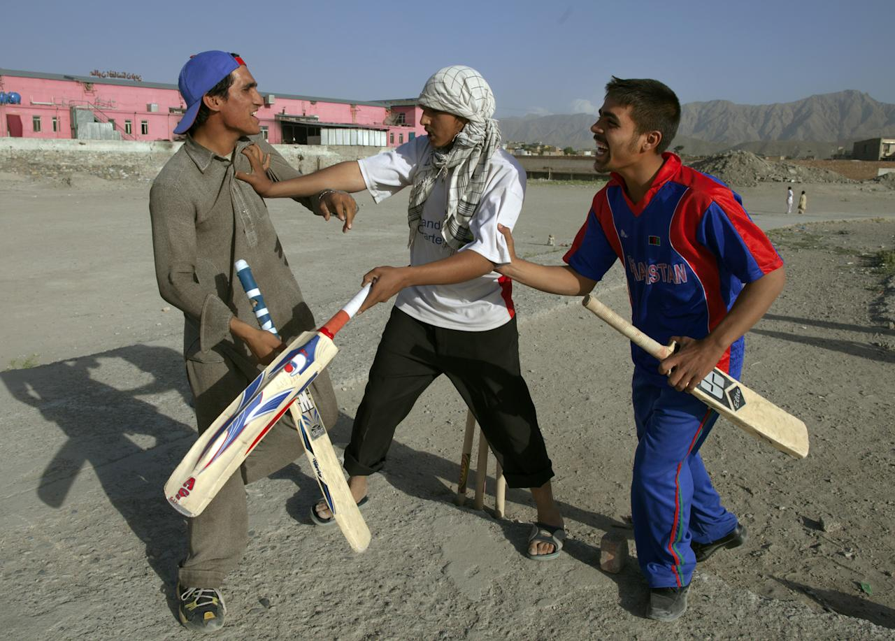 KABUL, AFGHANISTAN - JUNE 15:  Pashtun cricket players argue over the score June 15, 2011 in Kabul, Afghanistan. Cricket enthusiasm continues to grow as Out of the Ashes, a documentary film about the Afghan cricket team's efforts to qualify for the sport's World Cup, gains more attention and awards. In the early 1990's, cricket quickly grew as a popular among Afghan refugees living in Pakistan. In 1995 the Afghanistan Cricket Federation was formed, but under the Taliban rule, like all sports, cricket was originally banned. Cricket became an exception in 2000 and the following year the Afghanistan Cricket Federation was elected as an affiliate member of the ICC.  (Photo by Paula Bronstein /Getty Images)
