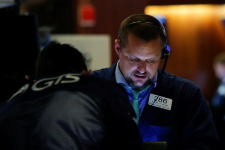 Traders work on the floor at the New York Stock Exchange (NYSE) in New York