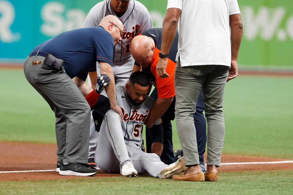 Detroit Tigers' Derek Hill is helped up off the field during the fifth inning of a baseball game against the Tampa Bay Ray Saturday, Sept. 18, 2021, in St. Petersburg, Florida.