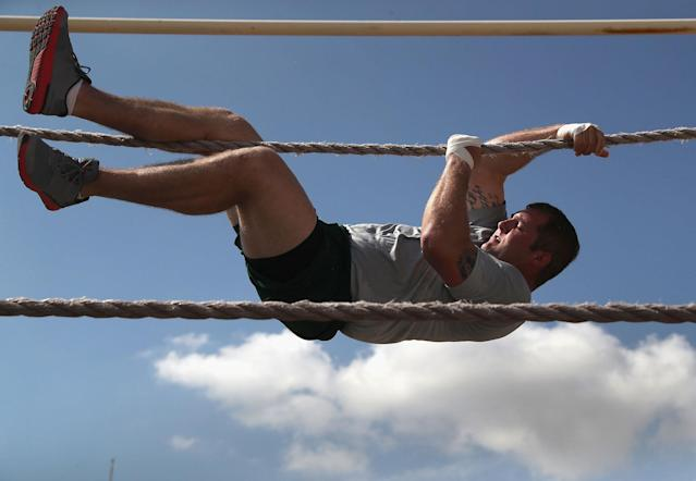 <p>A trainee completes an obstacle course at the U.S. Border Patrol Academy on August 2, 2017 in Artesia, N.M. (Photo: John Moore/Getty Images) </p>