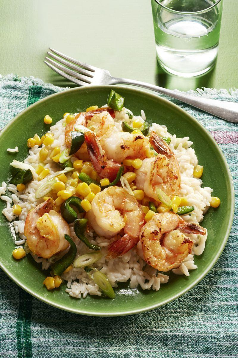 """<p>In the mood for seafood? This easy shrimp-and-rice combo is sure to satisfy.</p><p><em><a href=""""https://www.womansday.com/food-recipes/food-drinks/recipes/a56180/sauteed-shrimp-poblanos-and-corn-with-creamy-rice-recipe/"""" rel=""""nofollow noopener"""" target=""""_blank"""" data-ylk=""""slk:Get the Sautéed Shrimp, Poblanos, and Corn with Creamy Rice recipe."""" class=""""link rapid-noclick-resp"""">Get the Sautéed Shrimp, Poblanos, and Corn with Creamy Rice recipe.</a></em></p>"""