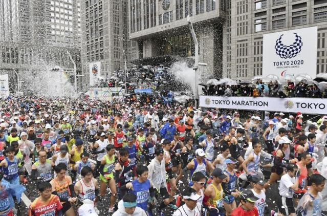Runners fill the street at the start of the Tokyo Marathon in Tokyo, Japan