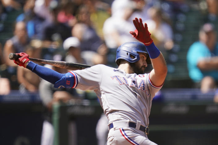 Texas Rangers' Joey Gallo strikes out swinging against the Seattle Mariners to end the sixth inning of a baseball game Sunday, July 4, 2021, in Seattle. (AP Photo/Elaine Thompson)