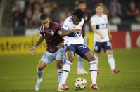 Colorado Rapids defender Lucas Esteves, left, fights for control of the ball with Vancouver Whitecaps defender Javain Brown in the first half of an MLS soccer match Sunday, Sept. 19, 2021, in Commerce City, Colo. (AP Photo/David Zalubowski)