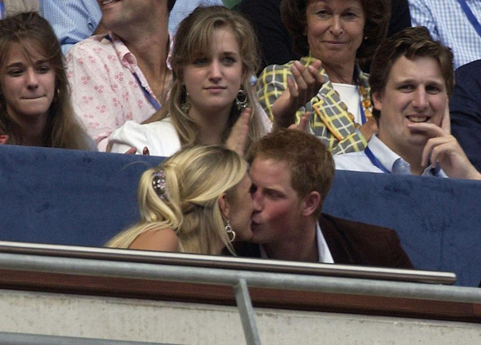 """<p>Harry was spotted kissing his then-girlfriend Chelsy Davy during a concert in 2007—a major no-no for a royal. The pair dated from 2005 to 2010, and she's since thrown a lil' shade, <a href=""""http://people.com/royals/prince-harrys-ex-chelsy-davy-opens-up-about-relationship/"""" rel=""""nofollow noopener"""" target=""""_blank"""" data-ylk=""""slk:saying"""" class=""""link rapid-noclick-resp"""">saying</a> """"It was so full-on: crazy, and scary, and uncomfortable. I found it very difficult when it was bad. I couldn't cope."""" </p>"""