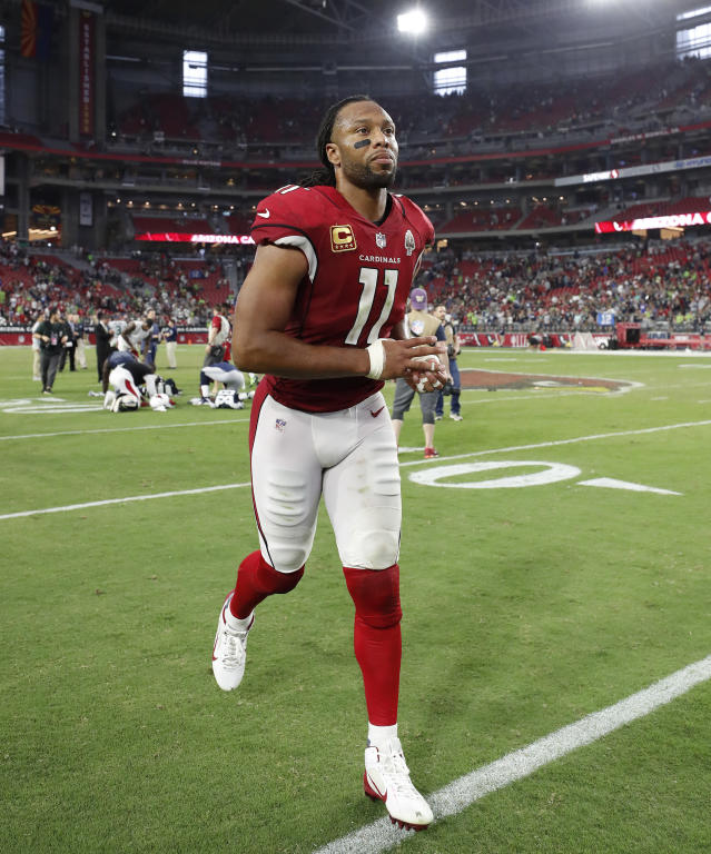 FILE - In this Sunday, Sept. 30, 2018, file photo, Arizona Cardinals wide receiver Larry Fitzgerald (11) runs off the field after an NFL football game against the Seattle Seahawks in Glendale, Ariz. Fitzgerald says it's the wins that keep him playing in the NFL. If that's true, it must have been a pretty miserable first month to his 15th pro season. (AP Photo/Rick Scuteri, File)