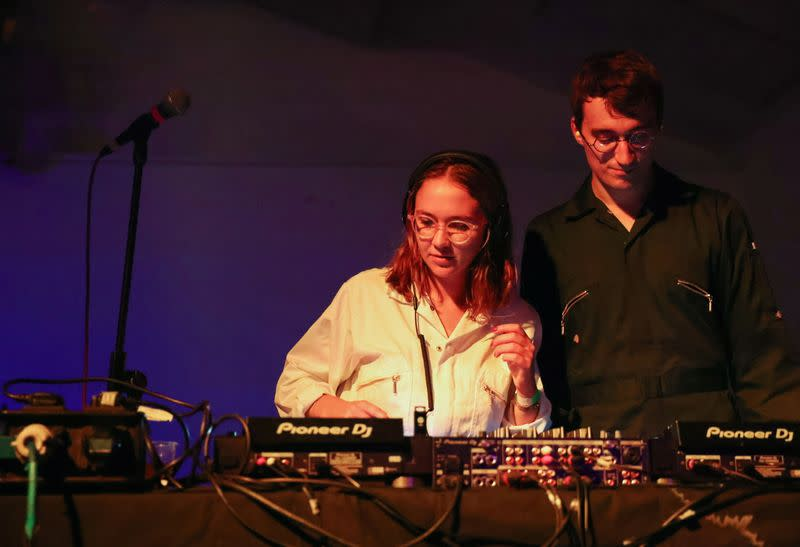 """Performers at a DJ console during the """"00:01"""" event organised by Egyptian Elbows at Oval Space nightclub, as England lifted most coronavirus disease (COVID-19) restrictions at midnight, in London"""