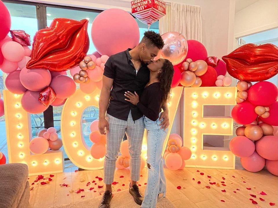 """<p>The Olympic gold medalist and the Houston Texans football player shared a smooch in front of an elaborate <a href=""""https://people.com/sports/simone-biles-celebrates-valentines-day-with-boyfriend-jonathan-owens/"""" rel=""""nofollow noopener"""" target=""""_blank"""" data-ylk=""""slk:Valentine's Day set-up"""" class=""""link rapid-noclick-resp"""">Valentine's Day set-up</a> at Biles's home in Texas. """"Lucky to be loved by you,"""" <a href=""""https://www.instagram.com/p/CLSf3AEB2fH/"""" rel=""""nofollow noopener"""" target=""""_blank"""" data-ylk=""""slk:wrote the gymnast"""" class=""""link rapid-noclick-resp"""">wrote the gymnast</a>. </p>"""