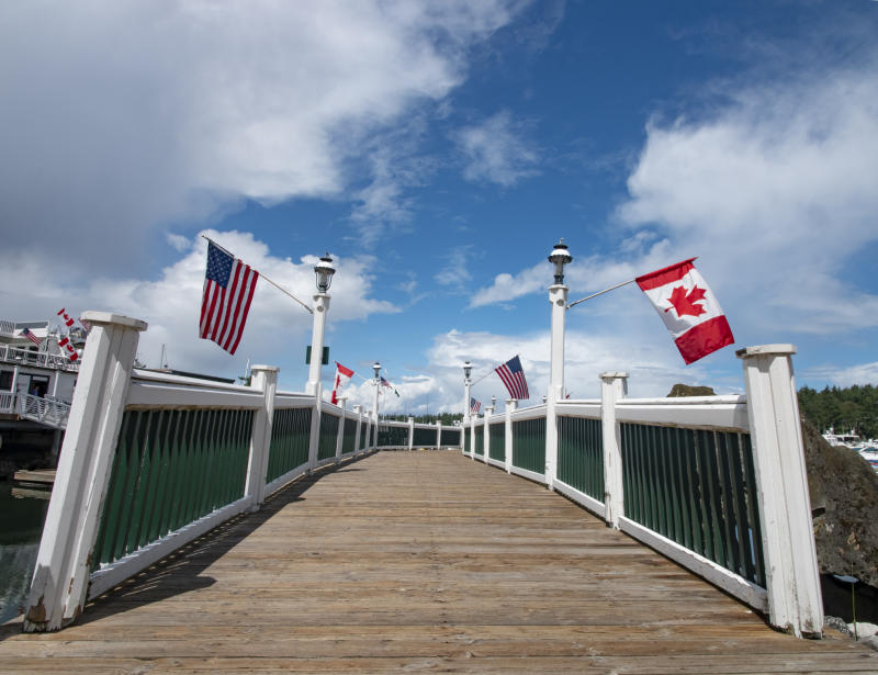 Walkway with U.S. and Canadian flags over the railing