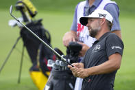 Ryan Moore watches his shot on the 18th hole during the first round of the 3M Open golf tournament in Blaine, Minn., Thursday, July 23, 2020. (AP Photo/Andy Clayton- King)