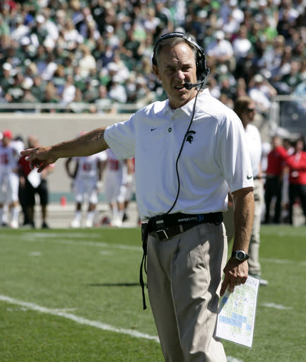 Michigan State coach Mark Dantonio gestures during the first quarter of an NCAA college football game against Youngstown State, Saturday, Sept. 14, 2013, in East Lansing, Mich. Michigan State won 55-17. (AP Photo/Al Goldis)