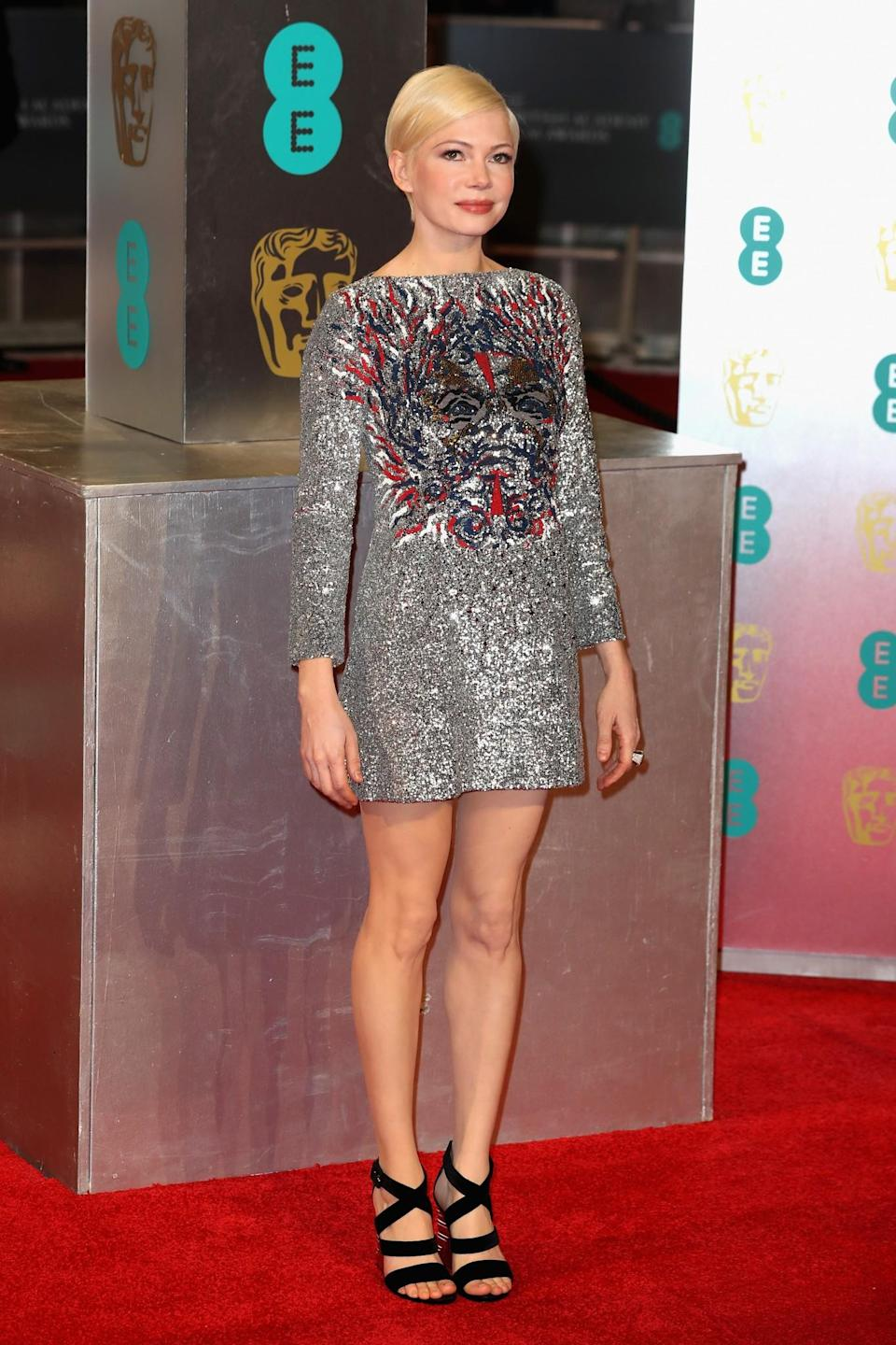 <p>The 'Manchester by the Sea' star slipped into a sequin mini dress by her go-to label, Louis Vuitton. <i>[Photo: Getty]</i> </p>