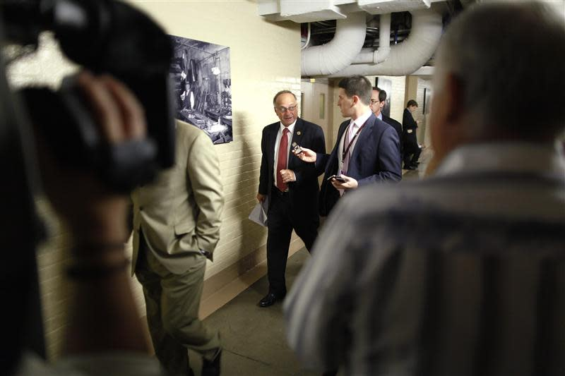 U.S. Representative King talks to a reporter as he arrives for a closed-door Republican caucus meeting at the U.S. Capitol in Washington