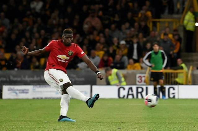 Social media giants Twitter have agreed to meet with Manchester United executives over the racial abuse of Paul Pogba after he missed a penalty and what can be done about preventing it (AFP Photo/Paul ELLIS )