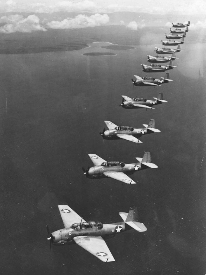 Circa 1950, these U.S. Navy 'Avenger' torpedo bombers fly in formation during a patrol over a Southwest Pacific island base. They are similar to those involved in the most famous Bermuda Triangle account from 1945 when five Navy Avengers went missing. (Three Lions / Getty Images)