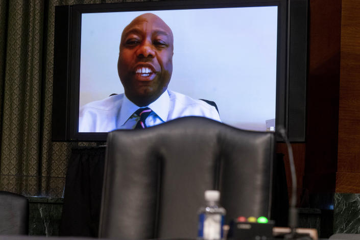 Sen. Tim Scott, R-S.C., speaks via teleconference during a Senate Finance Committee hearing to examine the expected nomination of Janet Yellen to be Secretary of the Treasury on Capitol Hill in Washington, Tuesday, Jan. 19, 2021. (AP Photo/Andrew Harnik, Pool)