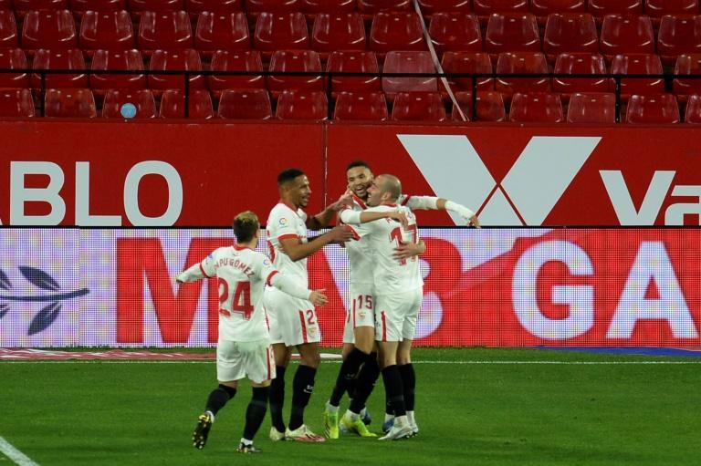Youssef en-Nesyri (2R) celebrates after completing the scoring for Sevilla in a 3-0 triumph over Getafe.