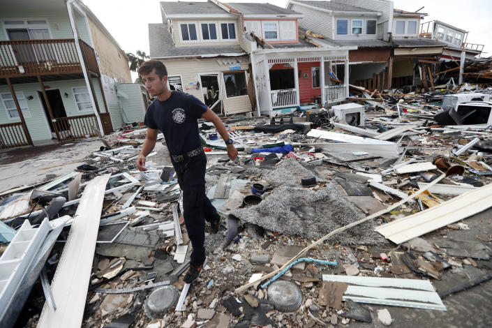 <p>Firefighter Austin Schlarb performs a door to door search in the aftermath of Hurricane Michael in Mexico Beach, Fla., Thursday, Oct. 11, 2018. (Photo: Gerald Herbert/AP) </p>