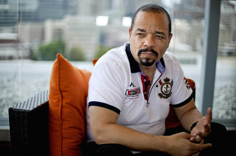"""This June 11, 2012 photo shows rapper and actor Ice-T in Atlanta. Ice-T wants to show the importance of lyricism in rap music through his new documentary, """"Something From Nothing: The Art of Hip-Hop,"""" which premieres in 150 theaters on Friday. (AP Photo/David Goldman)"""