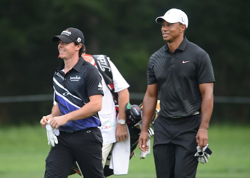 Tiger Woods, right, and Rory McIlroy of Northern Ireland walk down the 12th fairway during the Barclays golf tournament at Bethpage State Park in Farmingdale, N.Y., Thursday, Aug. 23, 2012. (AP Photos/Henny Ray Abrams)