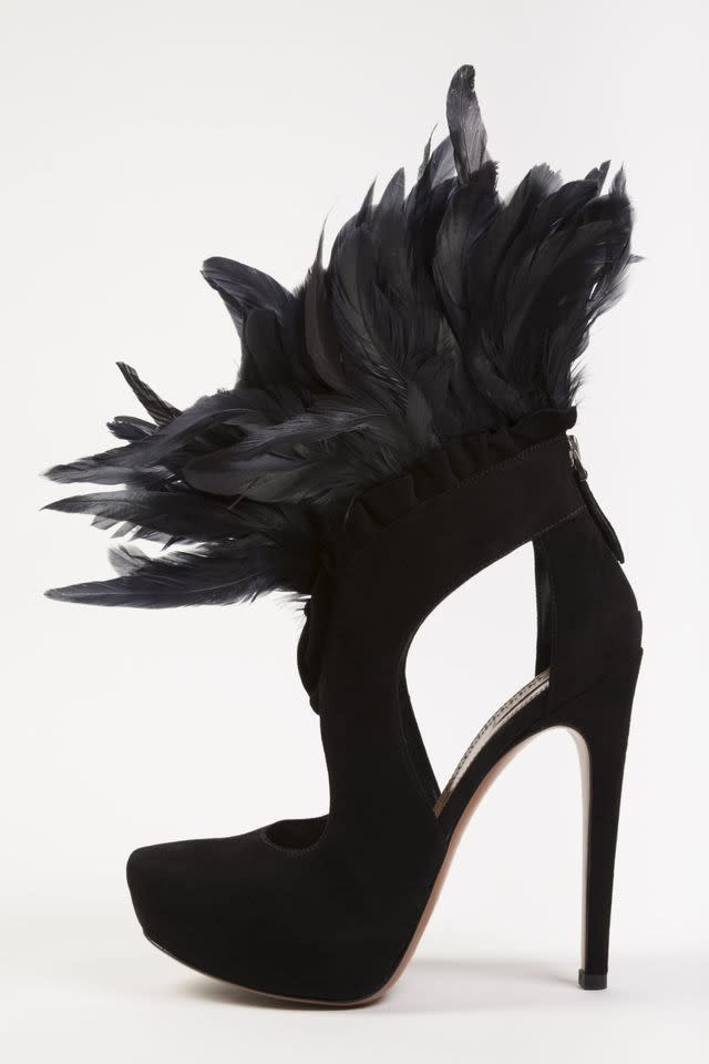 "In this undated photo provided by the Fashion Institute of Technology, shows a shoe decorated with feathers and designed by Azzedine Alaia. The shoe is on display at the ""Shoe Obsession"" exhibit at The Museum at the Fashion Institute of Technology Museum in New York. The exhibition, showing off 153 specimens, runs through April 13. (AP Photo/Fashion Institute of Technology)"