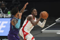 Houston Rockets guard Victor Oladipo, right, shoots against Charlotte Hornets forward Miles Bridges in the first half of an NBA basketball game in Charlotte, N.C., Monday, Feb. 8, 2021. (AP Photo/Nell Redmond)