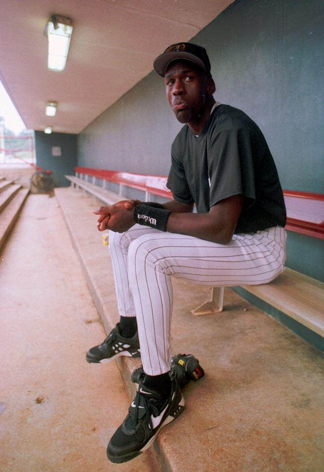 Michael Jordan sits in the dugout of the Hoover Metropolitan Stadium on the first day of practice as a minor league ball player on April 6, 1994. (AP Photo/Dave Martin)