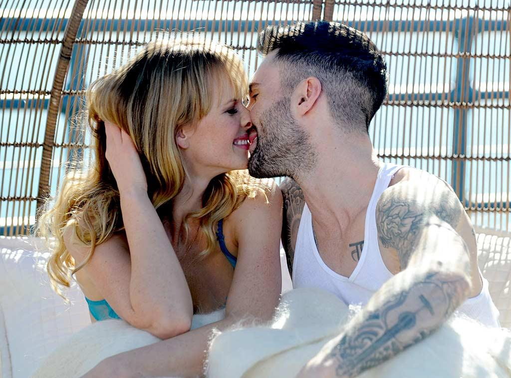 "The cute couple also shared an intimate kiss ... in front of the music video crew and a crowd of fans. ""I think that shooting this video has officially broken down all of my social barriers,"" joked Levine on his Twitter. Whittle/<a href=""http://www.splashnewsonline.com"" target=""new"">Splash News</a> - January 11, 2011"