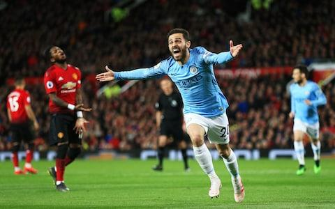 Bernardo Silva of Manchester City celebrates after scoring his teams first goal during the Premier League match between Manchester United and Manchester City at Old Trafford - Credit: GETTY IMAGES