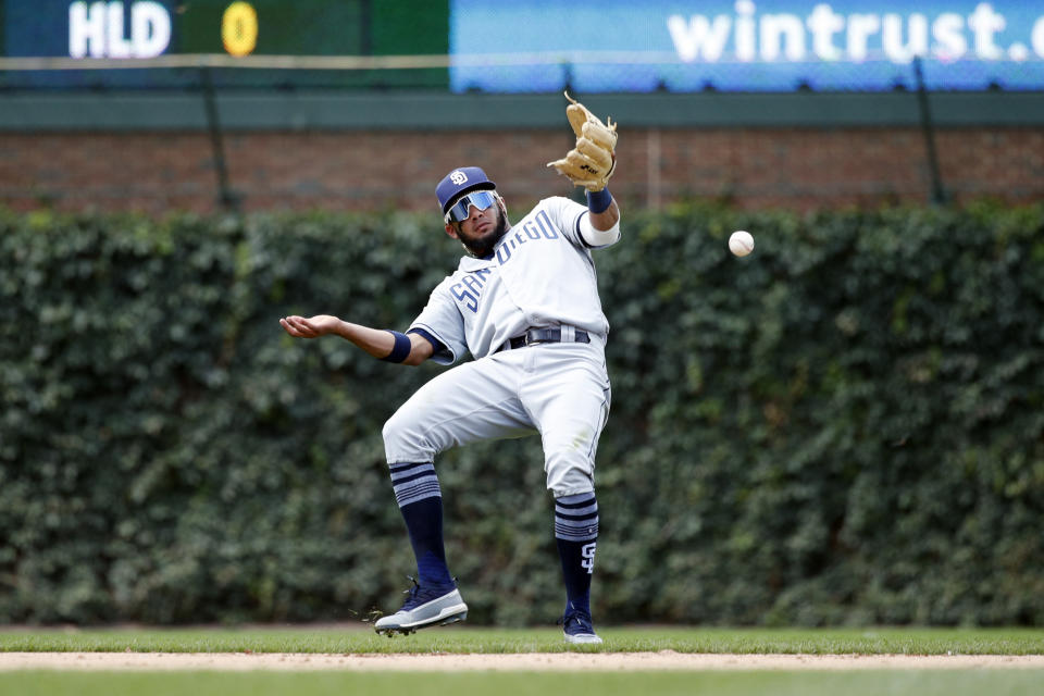 CHICAGO, IL - JULY 20: Fernando Tatis Jr. #23 of the San Diego Padres bobbles the ball after a bad hop while trying to field a grounder against the Chicago Cubs at Wrigley Field on July 20, 2019 in Chicago, Illinois. The Cubs won 6-5. (Photo by Joe Robbins/Getty Images)