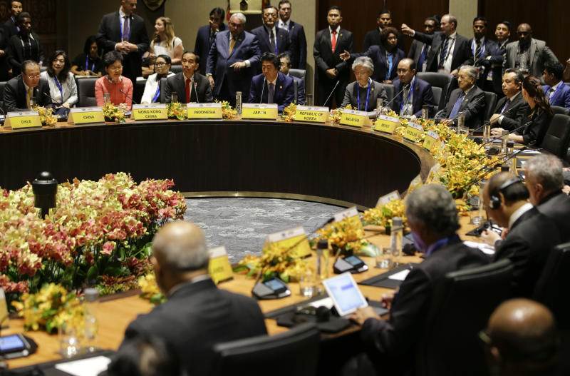 FILE - In this Nov. 17, 2018, file photo, leaders listen during the Pacific Islands Countries Informal Dialogue with APEC Leaders in Port Moresby, Papua New Guinea. New Zealand on Tuesday, June 30, 2020, canceled its plans to host a major meeting of U.S. and Asian leaders next year because of the coronavirus, opting instead to lead a virtual summit. (AP Photo/Aaron Favila)