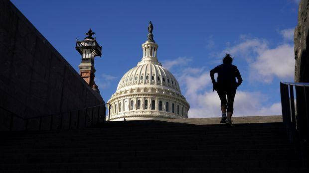 A woman exercises on steps at the U.S. Capitol