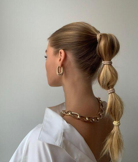 "<p><strong>Forget your regular ol' pony and grab a bunch of <a href=""https://www.amazon.com/Goody-Ouchless-Womens-Braided-Elastic/dp/B00DFSHD5O/ref=sr_1_5?tag=syn-yahoo-20&ascsubtag=%5Bartid%7C10049.g.35203490%5Bsrc%7Cyahoo-us"" rel=""nofollow noopener"" target=""_blank"" data-ylk=""slk:hair elastics"" class=""link rapid-noclick-resp"">hair elastics</a></strong> to recreate this spring 2021 hair trend. So cute, right? Pro tip: Smooth on a <a href=""https://go.redirectingat.com?id=74968X1596630&url=https%3A%2F%2Fwww.ulta.com%2Fsilk-therapy-with-organic-coconut-oil%3FproductId%3DxlsImpprod18141047&sref=https%3A%2F%2Fwww.cosmopolitan.com%2Fstyle-beauty%2Fbeauty%2Fg35203490%2Fspring-2021-hair-trends%2F"" rel=""nofollow noopener"" target=""_blank"" data-ylk=""slk:non-greasy oil"" class=""link rapid-noclick-resp"">non-greasy oil </a>to slick down any rogue flyaways.</p><p><a href=""https://www.instagram.com/p/CGzu6V2lSwy/"" rel=""nofollow noopener"" target=""_blank"" data-ylk=""slk:See the original post on Instagram"" class=""link rapid-noclick-resp"">See the original post on Instagram</a></p>"