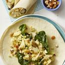 """<p>For a quick and easy lunch (that tastes nothing like Thanksgiving dinner), toss turkey with sweet golden raisins, crunchy toasted almonds and curry powder and pile it into a wrap.</p><p><em><a href=""""https://www.goodhousekeeping.com/food-recipes/easy/a28223804/coronation-chicken-salad-wraps-recipe/"""" rel=""""nofollow noopener"""" target=""""_blank"""" data-ylk=""""slk:Get the recipe for Coronation Turkey Salad Wraps »"""" class=""""link rapid-noclick-resp"""">Get the recipe for Coronation Turkey Salad Wraps »</a></em></p>"""