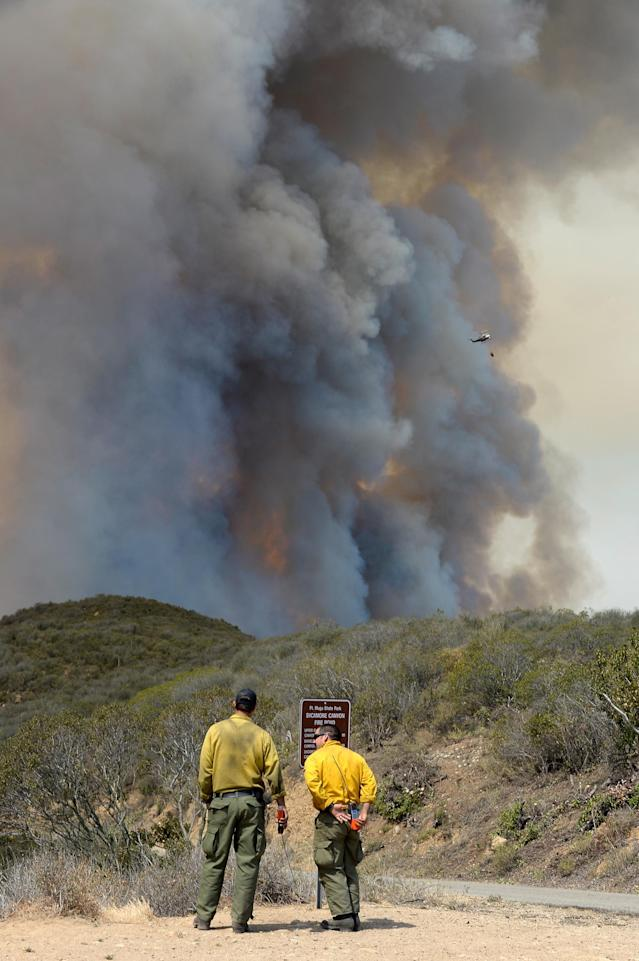 NEWBURY PARK, CA - MAY 03: Firefighters look on as wildfire charges back up from Sycamore Canyon inside Pt. Mugu State Park after changing winds on May 3, 2013 in Newbury Park, California. Hundreds of firefighters continue to battle wind and dry conditions with over 10,000 acres burned. (Photo by Kevork Djansezian/Getty Images)