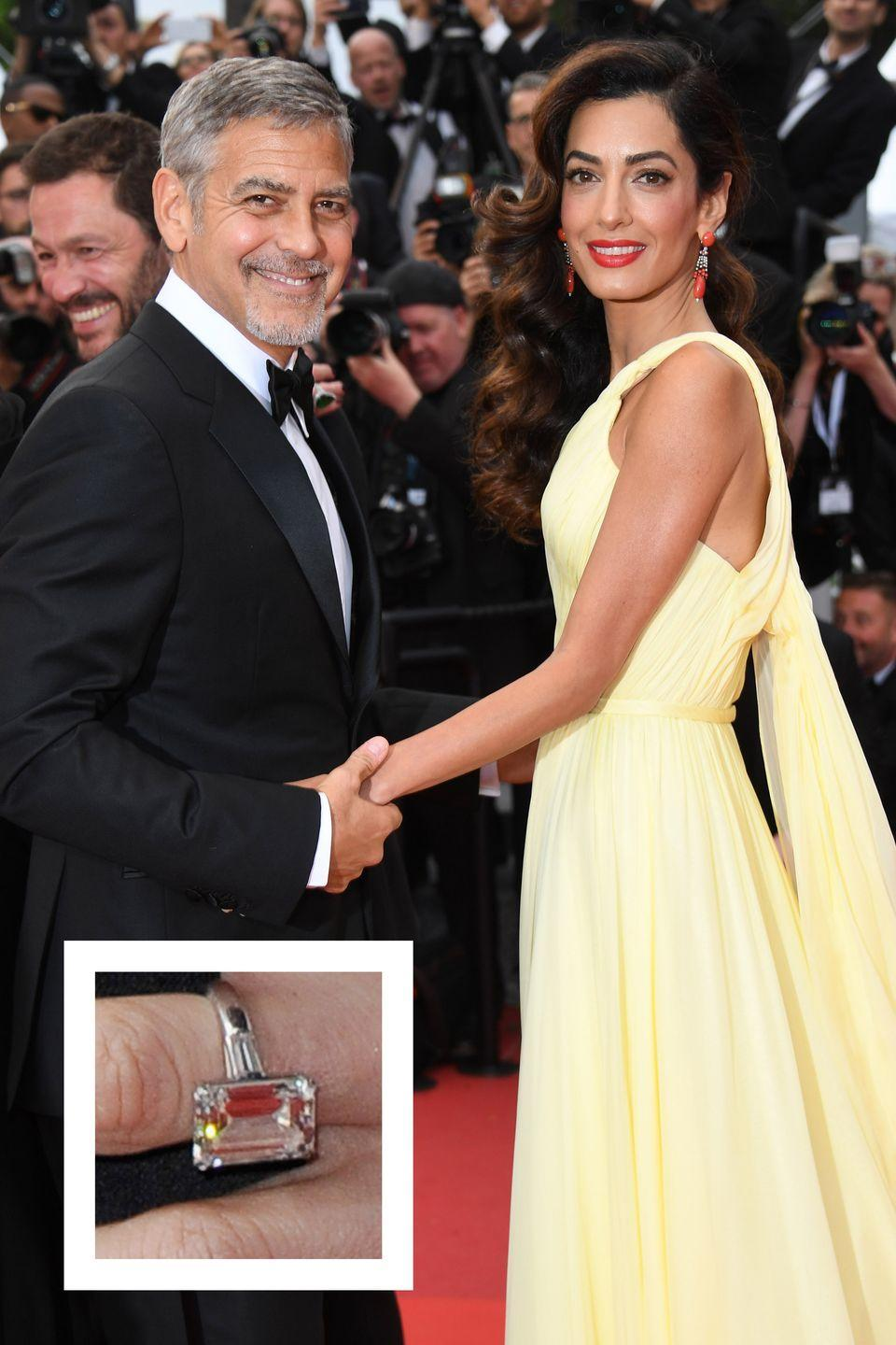 """<p>In April 2014, <a href=""""https://www.townandcountrymag.com/society/tradition/a10270315/george-amal-clooney-twins-photos/"""" rel=""""nofollow noopener"""" target=""""_blank"""" data-ylk=""""slk:longtime bachelor George Clooney"""" class=""""link rapid-noclick-resp"""">longtime bachelor George Clooney</a> proposed to <a href=""""https://www.townandcountrymag.com/society/money-and-power/a9984/amal-clooney-nadia-murad-1843-interview/"""" rel=""""nofollow noopener"""" target=""""_blank"""" data-ylk=""""slk:human-rights lawyer Amal Alamuddin"""" class=""""link rapid-noclick-resp"""">human-rights lawyer Amal Alamuddin </a>with <a href=""""https://www.townandcountrymag.com/style/fashion-trends/g2852/amal-clooney-best-looks/"""" rel=""""nofollow noopener"""" target=""""_blank"""" data-ylk=""""slk:a dazzling diamond ring."""" class=""""link rapid-noclick-resp"""">a dazzling diamond ring.</a> The ethically mined, seven carat emerald-cut center stone is set in platinum with two tapered baguettes on each side, <a href=""""http://people.com/celebrity/amal-alamuddins-engagement-ring-from-george-clooney-see-exclusive-photos/"""" rel=""""nofollow noopener"""" target=""""_blank"""" data-ylk=""""slk:People reports."""" class=""""link rapid-noclick-resp""""><em>People</em> reports.</a> The ring is <a href=""""http://www.eonline.com/news/537304/amal-alamuddin-s-750-000-engagement-ring-from-george-clooney-experts-weigh-in"""" rel=""""nofollow noopener"""" target=""""_blank"""" data-ylk=""""slk:estimated to cost"""" class=""""link rapid-noclick-resp"""">estimated to cost</a> $750,000.</p>"""