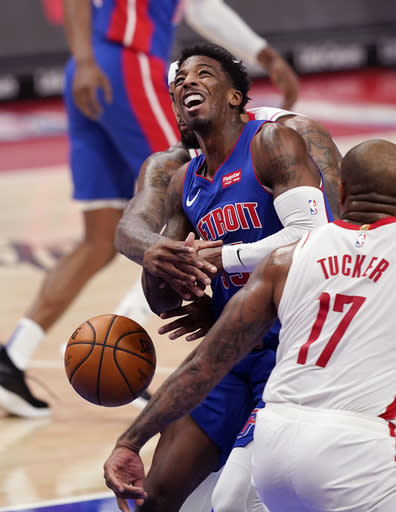 Houston Rockets center DeMarcus Cousins knocks the ball away from Detroit Pistons guard Delon Wright during the first half of an NBA basketball game, Friday, Jan. 22, 2021, in Detroit. (AP Photo/Carlos Osorio)