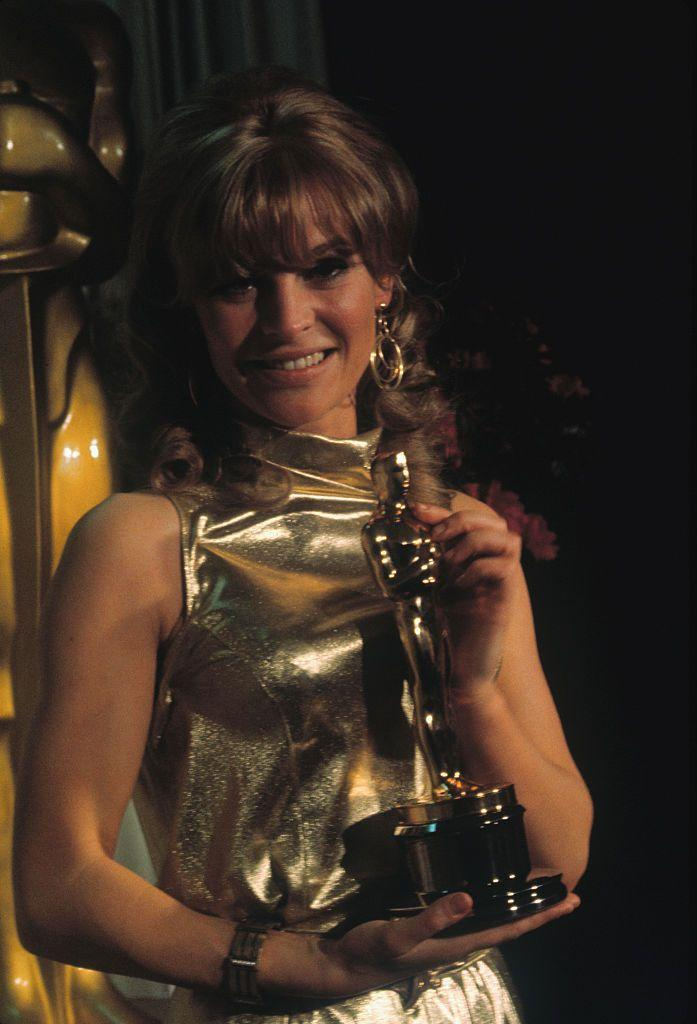 "<p>The Darling actress channeled her award in in a gold metallic high-neck frock. She <a href=""https://www.latimes.com/visuals/photography/la-me-fw-archives-christie-oscar-20170207-story.html"" rel=""nofollow noopener"" target=""_blank"" data-ylk=""slk:beat out Julie Andrews that year"" class=""link rapid-noclick-resp"">beat out Julie Andrews that year</a>, who had starred in <em>The Sound of Music</em>, so it was a pretty impressive win!</p>"