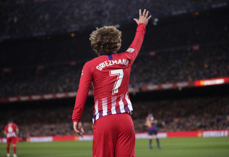 Atletico forward Antoine Griezmann reacts after putting a shot on goal straight in the arms of Barcelona goalkeeper Marc Andre ter Stegen during a Spanish La Liga soccer match between FC Barcelona and Atletico Madrid at the Camp Nou stadium in Barcelona
