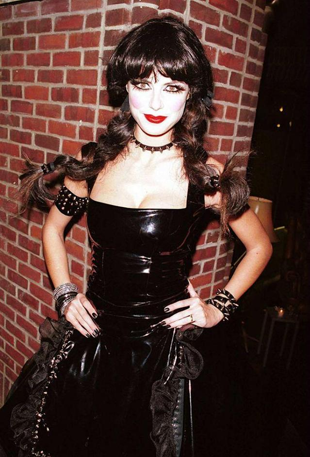 <p>No. 15: Embracing her German roots, Klum dressed as a goth St. Pauli Girl — sporting a bustier, braids, and black leather and spiked accessories — at her inaugural bash, which took place in 2000. It was fun and she looked sexy, but it was safe. She certainly got more creative from here. (Photo: DMIPhoto/FilmMagic) </p>