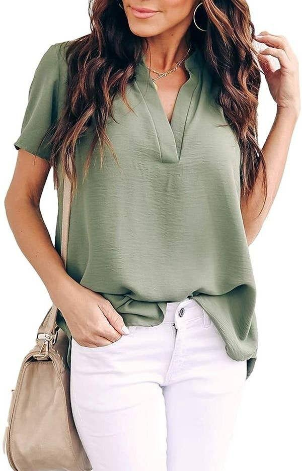 """Designed with a rounded hemline, this chic blouse also has crinkled fabric reviewers say<i>does not wrinkle</i>because that is an important factor that one of your fave tops absolutely needs.<br /><br /><strong>Promising review</strong>: """"I love this shirt.<strong>I bought it in two different colors because it's absolutely perfect for my office job.</strong>I got the grey and the floral one. They both fit me the same and I found they're true to size. I already have gotten compliments on my floral shirt.<strong>Now I am waiting for the black one to come back in stock. I am definitely going to order more colors!!</strong>"""" —<a href=""""https://www.amazon.com/gp/customer-reviews/R1SEF5YMUO4ZSP?&linkCode=ll2&tag=huffpost-bfsyndication-20&linkId=a22c8900c2872ff4f03cba025511802f&language=en_US&ref_=as_li_ss_tl"""" target=""""_blank"""" rel=""""nofollow noopener noreferrer"""" data-skimlinks-tracking=""""5876227"""" data-vars-affiliate=""""Amazon"""" data-vars-href=""""https://www.amazon.com/gp/customer-reviews/R1SEF5YMUO4ZSP?tag=bfchelsea-20&ascsubtag=5876227%2C18%2C35%2Cmobile_web%2C0%2C0%2C16401253"""" data-vars-keywords=""""cleaning,fast fashion"""" data-vars-link-id=""""16401253"""" data-vars-price="""""""" data-vars-product-id=""""20980953"""" data-vars-product-img="""""""" data-vars-product-title="""""""" data-vars-retailers=""""Amazon"""">Allysa Rice</a><br /><br /><strong><a href=""""https://www.amazon.com/Allimy-Summer-Neckline-Chiffon-Blouses/dp/B08832Z6MB?&linkCode=ll1&tag=huffpost-bfsyndication-20&linkId=8a3343e4ecdb2d707c78a06c6ca21306&language=en_US&ref_=as_li_ss_tl"""" target=""""_blank"""" rel=""""noopener noreferrer"""">Get it from Amazon for$22.99(available in sizes S-XXL and in 21 colors).</a></strong>"""