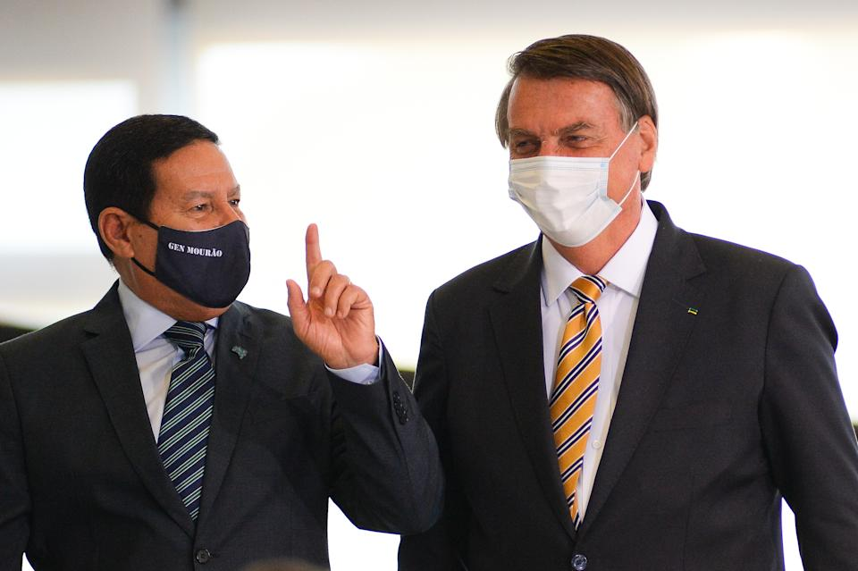 BRASILIA, BRAZIL - JUNE 23: Vice President of Brazil Hamilton Mourão and President Jair Bolsonaro arrive for a forum on Borders Protection at Planalto Government Palace on June 23, 2021 in Brasilia, Brazil. (Photo by Andressa Anholete/Getty Images)