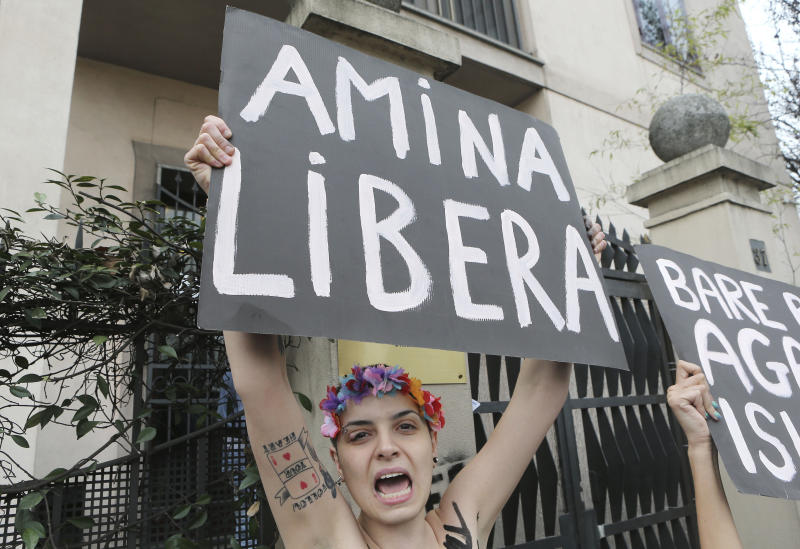 FILE - In this April 4, 2013 file photo, a FEMEN activist protest in front of the Tunisian Consulate in Milan, Thursday, April 4, 2013. The radical feminists, calling for more sexual freedom for Arab women, were protesting in support of a young Tunisian woman who received online death threats from ultraconservative Muslims after posting topless photos of herself online. Women's rights activists across the middle east fear the topless protests may hurt their cause more than help it. (AP Photo/Antonio Calanni, File)