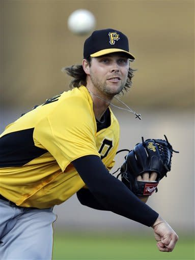 Pittsburgh Pirates starting pitcher Kyle McPherson warms up for the first inning of an exhibition spring training baseball game against the Tampa Bay Rays in Port Charlotte, Fla., Monday, March 25, 2013. (AP Photo/Elise Amendola)