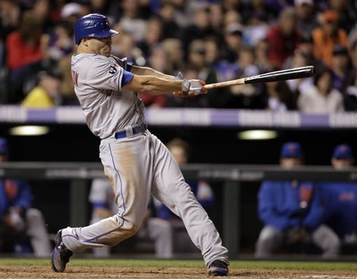New York Mets' Scott Hairston hits a triple against the Colorado Rockies in the fifth inning of their baseball game in Denver on Friday, April 27, 2012. (AP Photo/Joe Mahoney)
