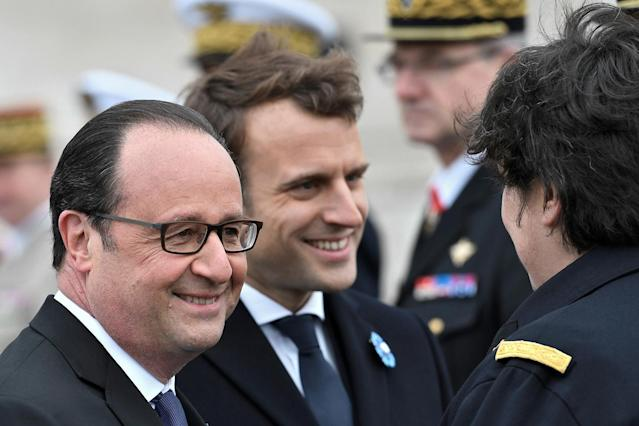 <p>Current French President Francois Hollande, left, and president-elect Emmanuel Macron attend a ceremony to mark the end of World War II at the Arc de Triomphe in Paris, Monday, May 8, 2017. (Stephane De Sakutin/Pool/Reuters) </p>