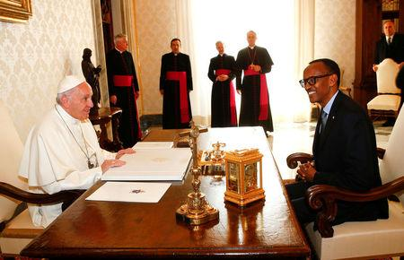 Pope Francis talks with Rwanda's President Paul Kagame during a private meeting at the Vatican